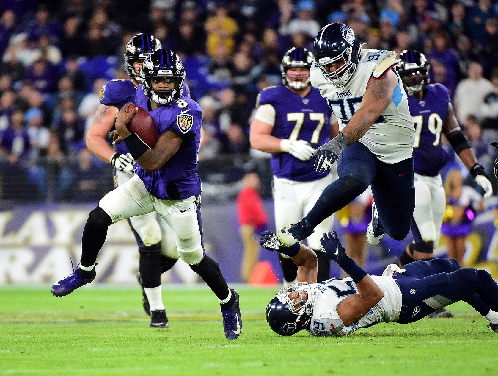Jan 11, 2020; Baltimore, Maryland, USA; Baltimore Ravens quarterback Lamar Jackson (8) runs with the ball in the third quarter against the Tennessee Titans in a AFC Divisional Round playoff football game at M&T Bank Stadium. Mandatory Credit: Evan Habeeb-USA TODAY Sports