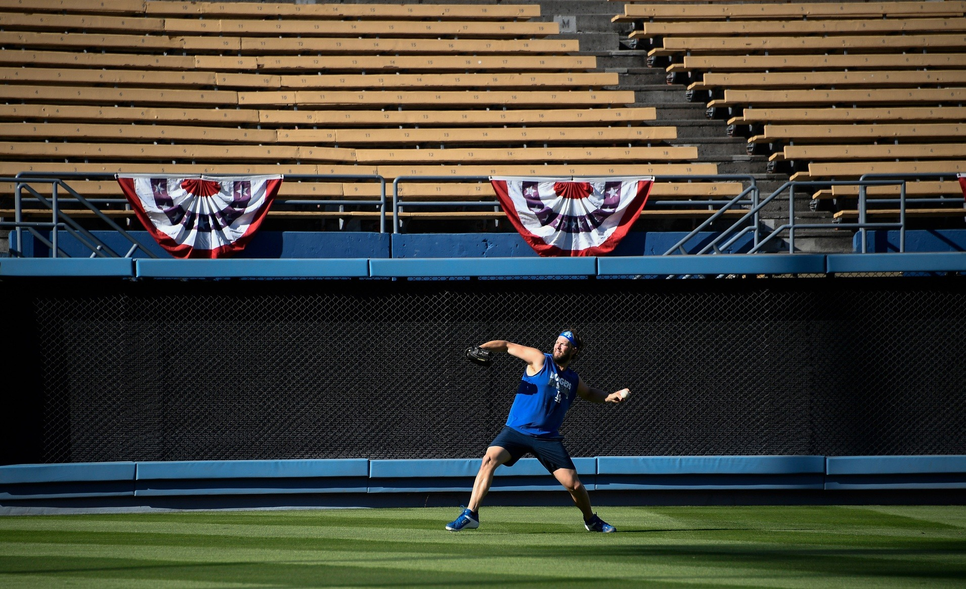 guy throwing with nobody in the stands